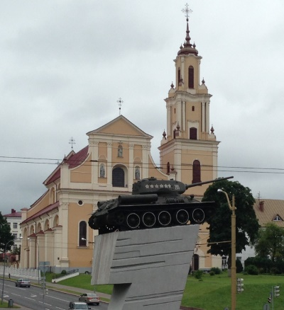 Soviet tank on the background of the church in Grodno